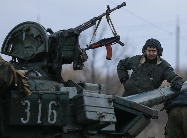 A Ukrainian serviceman stands on a tank near Artemivsk, eastern Ukraine, February 8, 2015. (Photo by Gleb Garanich/Reuters)