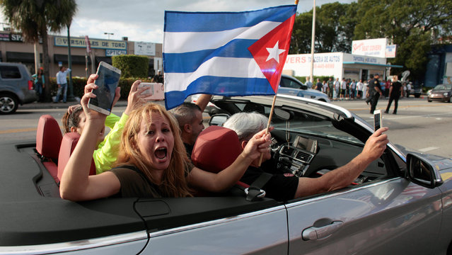 People celebrate after the announcement of the death of Cuban revolutionary leader Fidel Castro, in the Little Havana district of Miami, Florida, U.S. November 26, 2016. (Photo by Javier Galeano/Reuters)