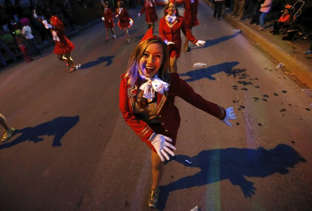 A member of the Amelia Earhawts Cabin Krewe participates in a Mardi Gras parade along St. Charles Avenue in New Orleans, Louisiana February 12, 2015. (Photo by Jonathan Bachman/Reuters)