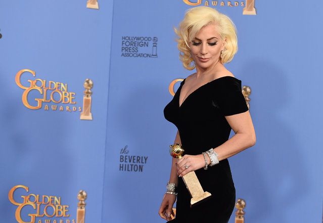 """Lady Gaga poses in the press room with the award for best performance by an actress in a limited series or a motion picture made for television for """"American Horror Story: Hotel"""" at the 73rd annual Golden Globe Awards on Sunday, January 10, 2016, at the Beverly Hilton Hotel in Beverly Hills, Calif. (Photo by Jordan Strauss/Invision/AP Photo)"""