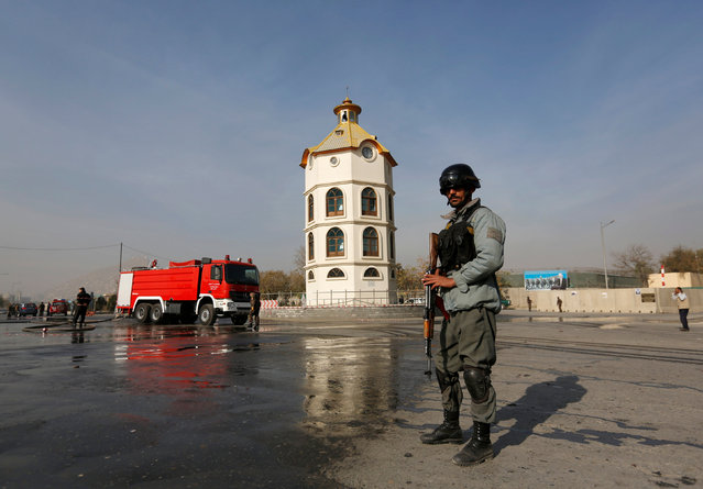 An Afghan policeman stands guard at the site of a suicide bombing in Kabul, Afghanistan, November 16, 2016. (Photo by Mohammad Ismail/Reuters)