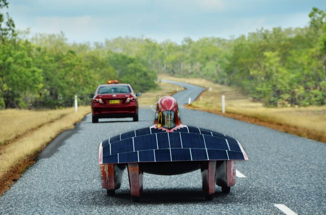 A handout image of the Red Engine Team obtained on 04 October 2013 shows the Red Engine solar car during a test drive on Cox Penninsula Road outside Darwin, Australia, 16 September 2013. The Dutch vehicle is competing in the World Solar Challenge, driving from Darwin to Adelaide starting on 06 October 2013. (Photo by Joost Van Baars/EPA/Red Engine Team)