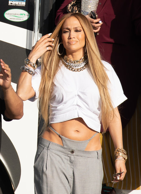 Jennifer Lopez matches her thong to her baggy pants as she shoots a music video with DJ Khaled in Miami on November 15, 2018. The famously curvy superstar appeared to have her skimpy briefs sewn onto her low slung bottoms as she flashes her taut midriff while filming. (Photo by Splash News and Pictures)