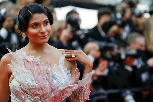 """A guest arrives for the screening of the film """"France"""" at the 74th edition of the Cannes Film Festival in Cannes, southern France, on July 15, 2021 . (Photo by Sarah Meyssonnier/Reuters)"""
