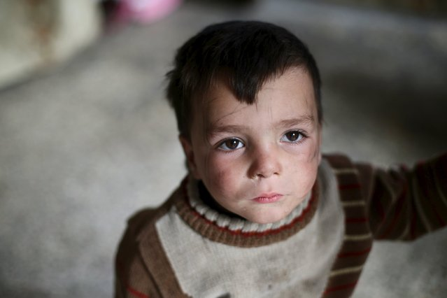 Atef, 2, Shahrour's grandchild, stands in the courtyard of his grandfather's home in the besieged town of Arbeen, in the Damascus suburbs, Syria February 6, 2016. (Photo by Bassam Khabieh/Reuters)