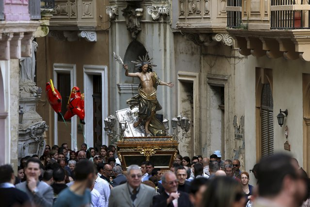 A statue of the Risen Christ is carried during an Easter Sunday procession in Cospicua, outside Valletta, Malta  April 5, 2015. (Photo by Darrin Zammit Lupi/Reuters)