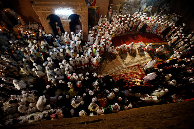 Ethiopian Orthodox choir members perform during Ethiopian Christmas Eve celebration in Bete Maryam (House of Mary) monolithic church in Lalibela, Ethiopia January 6, 2017. Picture taken January 6, 2017. (Photo by Tiksa Negeri/Reuters)
