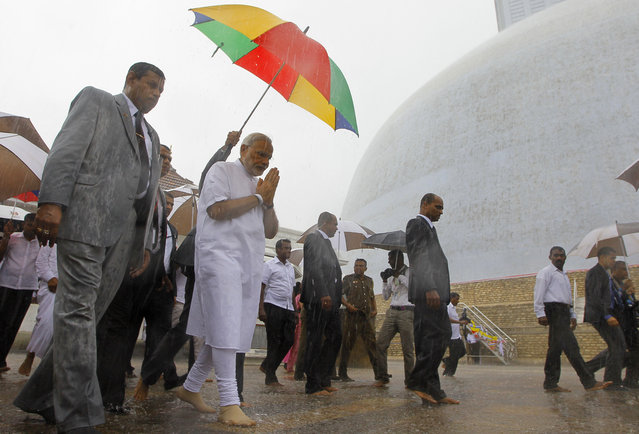Indian Prime Minister Narendra Modi folds his hands in a sign of respect during his visit to Ruwanwelisaya, a sacred stupa in Anuradhapura, about 230 kilometers northeast of Colombo, Sri Lanka, Saturday, March 14, 2015. Modi said on Friday that India's neighbors should be the first beneficiaries of the nation's economic progress as he sought to woo smaller Indian Ocean states away from increasing Chinese influence. (Photo by Eranga Jayawardena/AP Photo)