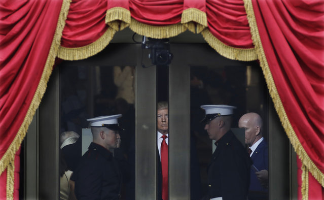 President-elect Donald Trump waits to stop out onto the portico for his Presidential Inauguration at the U.S. Capitol in Washington, Friday, January 20, 2017. (Photo by Patrick Semansky/AP Photo)