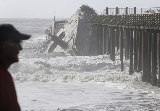 In this Saturday, January 21, 2017, photo, waves crash into the historic WW1-era ship called S.S. Palo Alto at Rio Del Mar in Aptos, Calif., after it was torn apart during a storm. The National Weather Service cautioned that the system was expected to gain strength into the evening Sunday and could be the strongest storm in at least seven years. (Photo by Kevin Johnson/The Santa Cruz Sentinel via AP Photo)