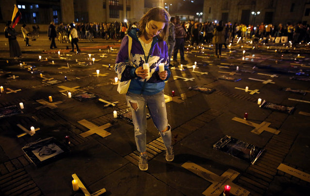 People participate in a rally for the Day of Dignity for the Victims of State Crimes at the Plaza de Bolivar in Bogota, Colombia, 06 March 2019. (Photo by Leonardo Muñoz/EPA/EFE)