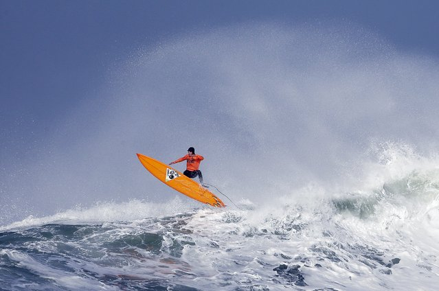 Tyler Fox flies out of a wave during the second heat of the first round of the Mavericks Invitational big wave surf contest Friday, January 24, 2014, in Half Moon Bay, Calif. (Photo by Eric Risberg/AP Photo)