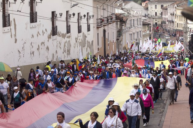 Ecuadorean supporters of President Rafael Correa march to commemorate International Workers' Day, on the streets of Quito May 1, 2015. (Photo by Guillermo Granja/Reuters)