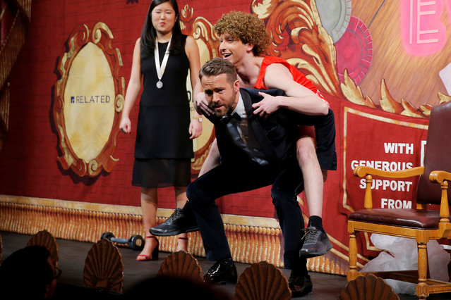 Actor Ryan Reynolds does squats with Hasty Pudding Theatricals cast member Scott Hall, playing the role of Richard Simmons, on his back during ceremonies to honor Reynolds as Hasty Pudding Theatricals Man of the Year at Harvard University in Cambridge, Massachusetts, U.S. February 3, 2017. (Photo by Brian Snyder/Reuters)