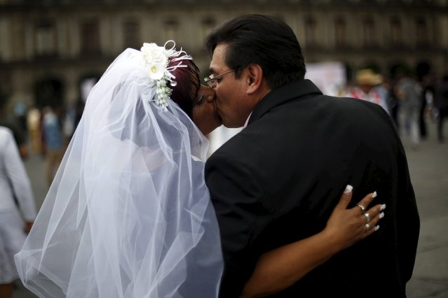 A couple kisses after a mass wedding ceremony in which 2,016 couples participated, at Zocalo square in Mexico City, Mexico, March 19, 2016. (Photo by Edgard Garrido/Reuters)