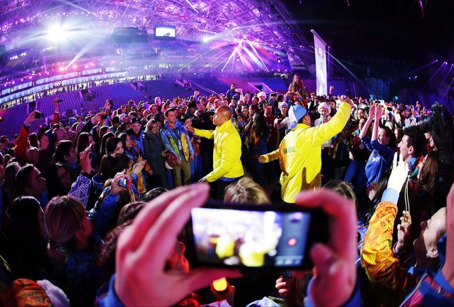 Athletes from Brazil dance during the closing ceremony. (Photo by Darron Cummings/Associated Press)
