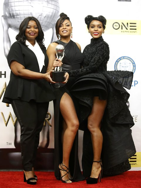"Actresses Taraji P. Henson (C), Janelle Monae (R) and Octavia Spencer pose with the award for Outstanding Motion Picture for ""Hidden Figures"" backstage at the 48th NAACP Image Awards in Pasadena, California, U.S., February 11, 2017. (Photo by Danny Moloshok/Reuters)"