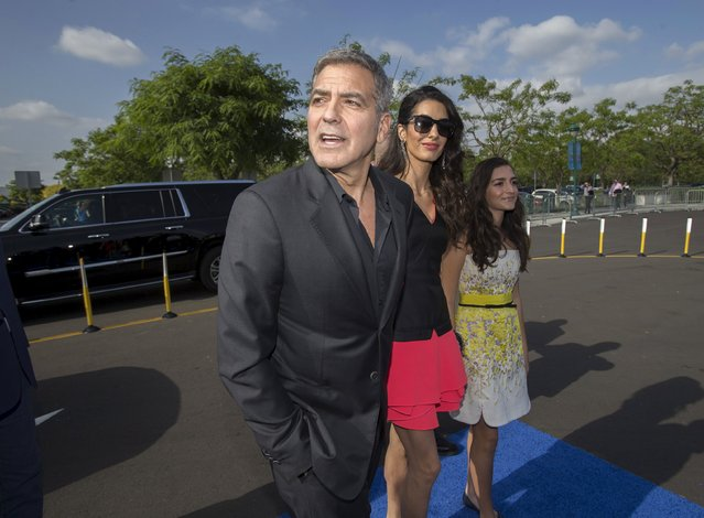 "Cast member George Clooney arrives with his wife Amal and her niece Mia at the premiere of ""Tomorrowland"" at AMC theatres in Downtown Disney in Anaheim, California May 9, 2015. (Photo by Mario Anzuoni/Reuters)"