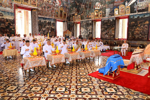 Royal astrologers and members of the Royal Thai court participate in a ritual ahead of the coronation to inscribe Thai King Maha Vajiralongkorn's name and title, cast the king's horoscope, and engrave the king's official seal at the Wat Phra Kaew or the Temple of the Emerald Buddha in Bangkok, Thailand April 23, 2019. (Photo by Thailand Royal Household via Reuters)