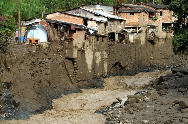 A street of the municipality of Salgar in Antioquia department is seen covered in mud and debris after a landslide in this May 19, 2015. (Photo by Fredy Builes/Reuters)