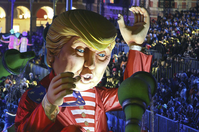 A huge U.S. President Donald Trump float parades during the Nice Carnival, Saturday, February 11, 2017, in Nice, southeastern France. (Photo by Henri Grivot/AP Photo)