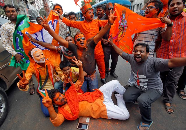 Supporters of Bharatiya Janata Party (BJP) celebrate after learning initial poll results in Kolkata, India, May 23, 2019. (Photo by Rupak De Chowdhuri/Reuters)