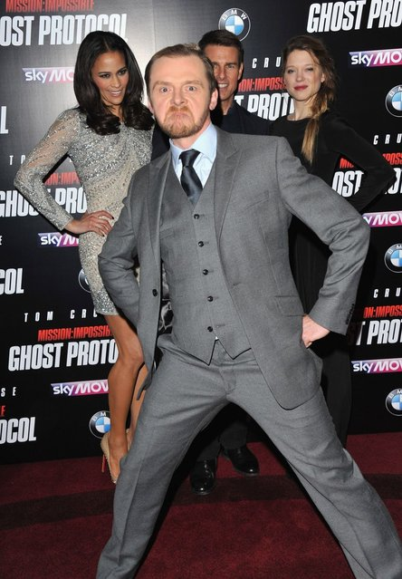 Simon Pegg steps in front of Paula Patton, Tom Cruise and Lea Seydoux at the Mission: Impossible Ghost Protocol UK Premiere. (Photo by Jon Furniss/WireImage)