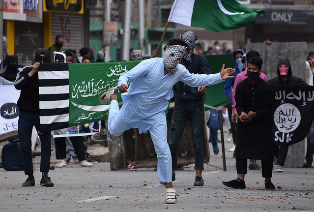 Protesters clash with at Indian police in old Srinagar, Kashmir, India on June 05, 2019.Massive anti India clashes erupt in old Srinagar soon after the Eid prayers culminated in Grand Mosque,police used teargas shells ,pellet fire and stun grenades to disperse the agitated protesters.Dozens of protesters received injuries locals in the area said. (Photo by Faisal Khan/Anadolu Agency/Getty Images)