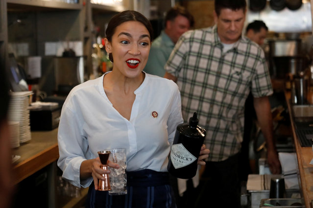 Rep. Alexandria Ocasio-Cortez (D-NY) walks to make a drink in support of One Fair Wage, a policy that would allow tipped workers to receive full minimum wage plus their tips in New York, at The Queensboro restaurant in the Queens borough of New York, U.S., May 31, 2019. (Photo by Shannon Stapleton/Reuters)