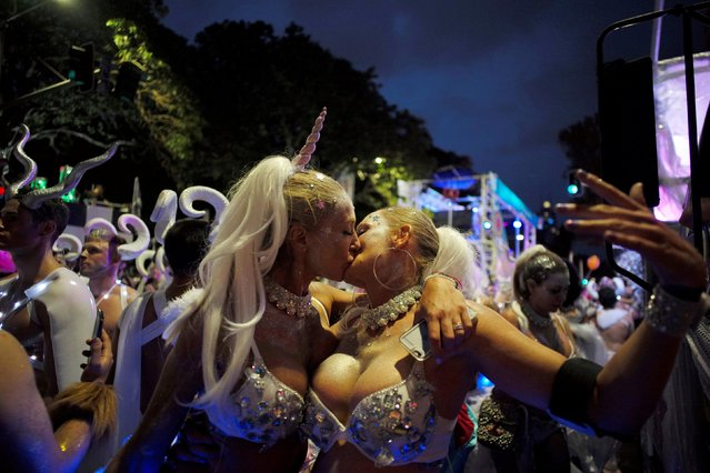 Two women wearing bejewelled bras kiss during the annual Sydney Gay and Lesbian Mardi Gras festival in Sydney, Australia March 4, 2017. (Photo by Jason Reed/Reuters)