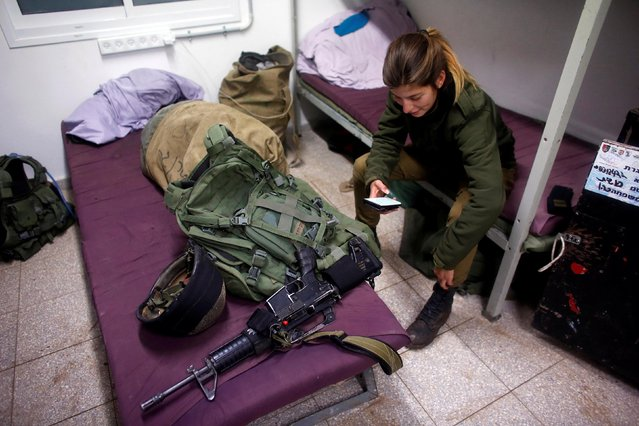 A female Israeli soldier from the Haraam artillery battalion sits on her bunk bed in the military base in the Israeli-occupied Golan Heights March 1, 2017. (Photo by Nir Elias/Reuters)
