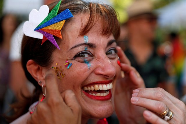 A participant poses for a portrait during the Gay Pride Parade in downtown Lisbon, Portugal on June 29, 2019. (Photo by Rafael Marchante/Reuters)