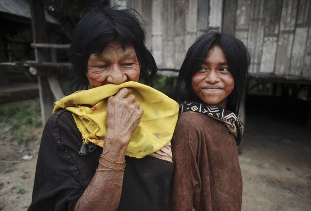Ashaninka Indians pose for a photograph in the village of Kokasul along the Envira river in Brazil's northwestern Acre state, March 16, 2014. (Photo by Lunae Parracho/Reuters)