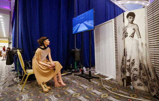 A model waits for a show backstage during Kazakhstan Fashion Week in Almaty, Kazakhstan, April 20, 2016. (Photo by Shamil Zhumatov/Reuters)
