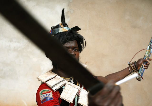 A member of the anti-balaka, a Christian militia, gestures with his machetes in the village of Zawa April 8, 2014. (Photo by Goran Tomasevic/Reuters)