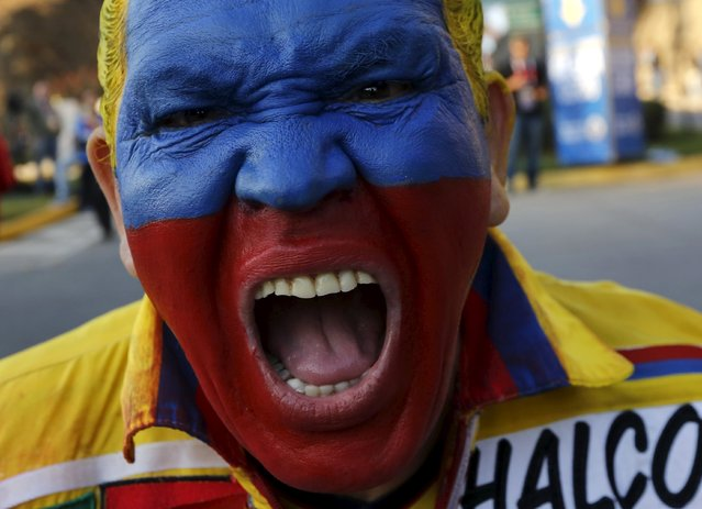 A fan of Colombia laughs as he arrives outside the stadium before their Copa America quarter-final soccer match against Argentina in Vina del Mar, Chile, June 26, 2015. (Photo by Henry Romero/Reuters)