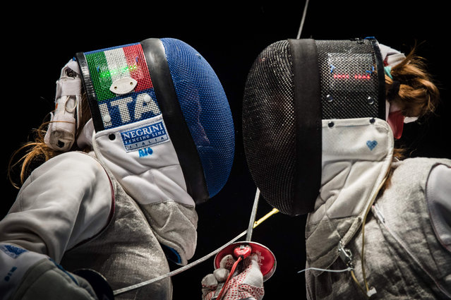 Italy's Valentina Vezzali (L) competes with Russia's Larisa Korobeynikova during the test event of the Fencing World Championships Women's Foil Team final match for the Rio 2016 Olympic Games at the Carioca Arena 3 of the Olympic Park in Rio de Janeiro, Brazil, on April 26, 2016. (Photo by Yasuyoshi Chiba/AFP Photo)