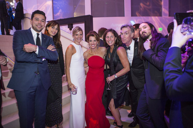 Ayman Mohyeldin, wife, and Kate Snow, Guests and Bill Nye, along with Steve Aoki group hug at the WHCD MSNBC After Party in Washington, U.S., April 30, 2016. (Photo by April Greer/The Washington Post)