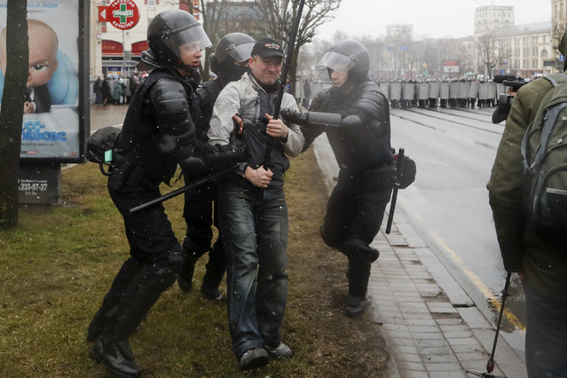 Belarus police detain an activist during an opposition rally in Minsk, Belarus, Saturday, March 25, 2017. (Photo by Sergei Grits/AP Photo)