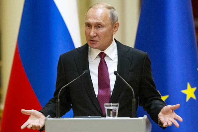 Russian President Vladimir Putin speaks during a news conference after his meeting with President of the Republic of Finland Sauli Niinisto at the President's official residence Mantyniemi in Helsinki, Finland, Wednesday, August 21, 2019. Putin has warned opposition protesters that they must abide by the law or face the consequences. (Photo by Alexander Zemlianichenko/AP Photo/Pool)