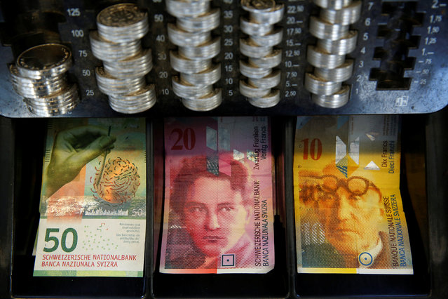 The new 50 Swiss Franc note is seen at a market stall after its release by the Swiss National Bank (SNB) in Bern, Switzerland April 12, 2016. (Photo by Ruben Sprich/Reuters)