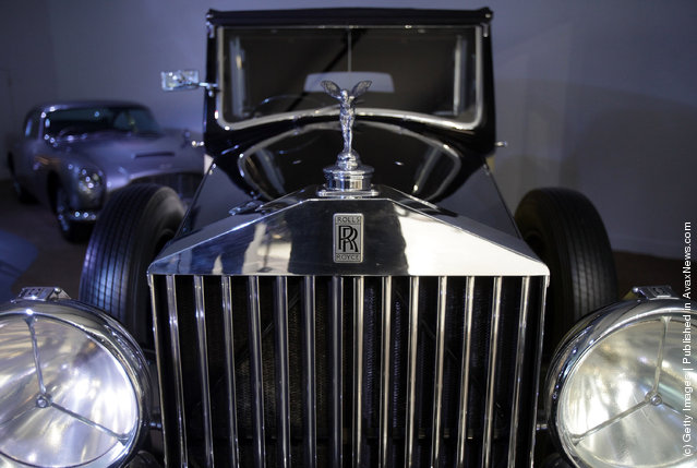 A Rolls-Royce Phantom III that was used in the James Bond film Goldfinger is displayed at the Bond In Motion exhibition