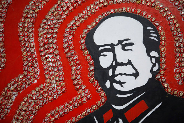Badges of late Chinese Chairman Mao Zedong decorate an image of Mao at Jianchuan Museum Cluster in Anren, Sichuan Province, China, May 13, 2016. (Photo by Kim Kyung-Hoon/Reuters)