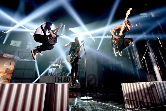 (L-R) Guitarist Michael Clifford, singer Luke Hemmings and guitarist Calum Hood of 5 Seconds of Summer rehearse onstage during the 2014 Billboard Music Awards at the MGM Grand Garden Arena on May 16, 2014 in Las Vegas, Nevada. (Photo by Kevin Winter/Billboard Awards 2014/Getty Images for DCP)