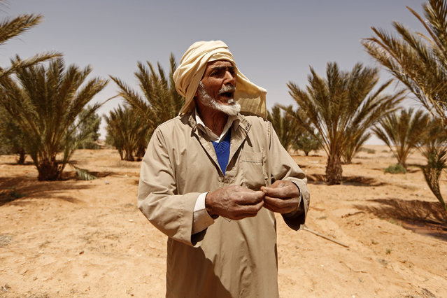 Yahya, father of Bechar Zongya, gestures during an interview with Reuters journalists in the town of Remada, Tunisia April 11, 2016. (Photo by Zohra Bensemra/Reuters)