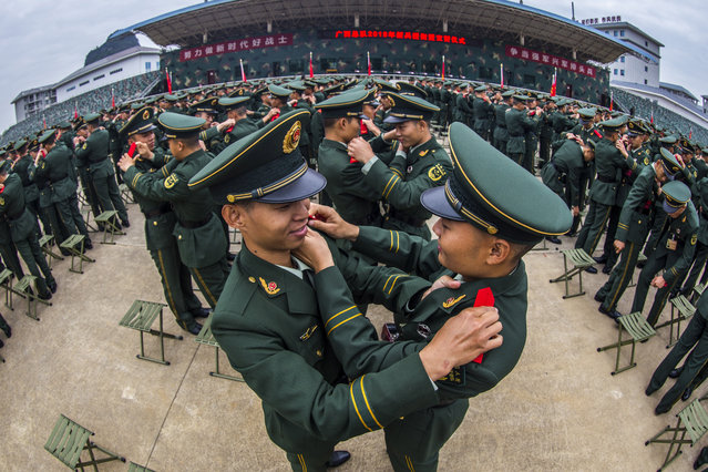 New recruits of the armed police at a swearing-in ceremony in Guangxi, China on November 20, 2019. (Photo by Costfoto/Barcroft Media)