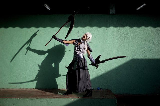 Cosplayer Alexis Martinez, who portrays Sengoku BASARA character Takenaka Hanbei, poses for a portrait during the 4th edition of the MiniCon Anime convention, at the School of Dance, in Managua, Nicaragua, Sunday, July, 26, 2015. (Photo by Esteban Felix/AP Photo)