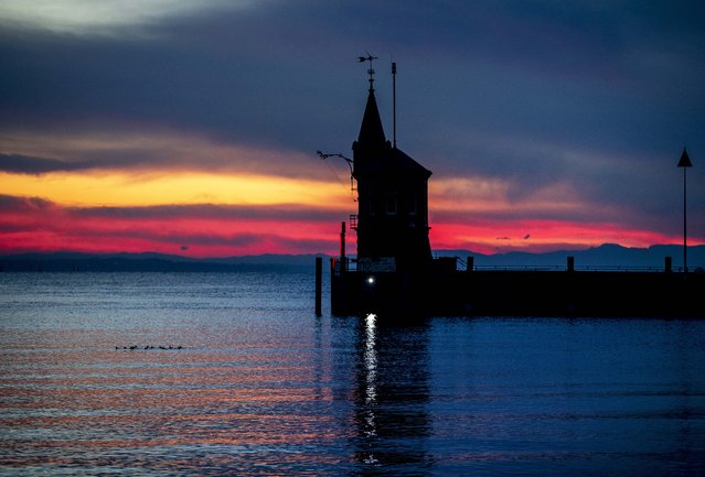 A small tower marks the entrance of the harbor of Constance, Germany, before sunrise Friday, November 15, 2019. (Photo by Michael Probst/AP Photo)