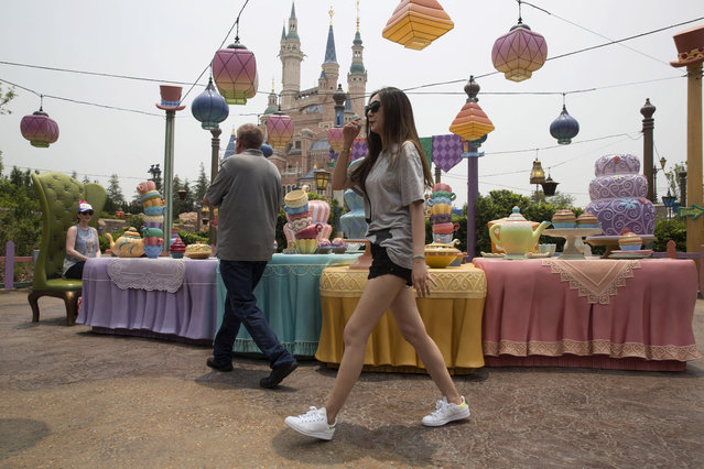 A visitor walks past an attraction on the eve of the opening of the Disney Resort in Shanghai, China, Wednesday, June 15, 2016. Disney will open its first resort in mainland China on Thursday. (Photo by Ng Han Guan/AP Photo)