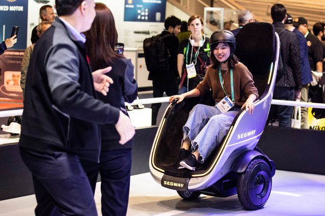 "A visitor tries the Segway ""S-Pod"" motorized chair on the manufacturer's booth during the 2020 International Consumer Electronics Show (CES) at the Las Vegas Convention Center in Las Vegas, Nevada, USA, 08 January 2020. (Photo by Etienne Laurent/EPA/EFE)"